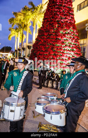 Miami Coral Gables Miami Florida Junior Orange Bowl Parade staging area community family event youth Black boy boys teen student high - Stock Photo