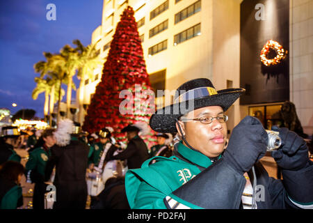 Miami Coral Gables Miami Florida Junior Orange Bowl Parade staging area community family event youth Black boy teen student high schoo - Stock Photo