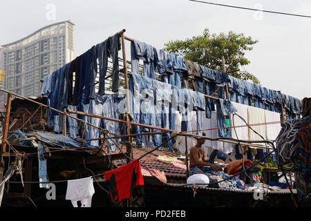 workers in Dhobi Ghat (Mahalaxmi Dhobi Ghat) a well known open air laundromat in Mumbai, India. - Stock Photo