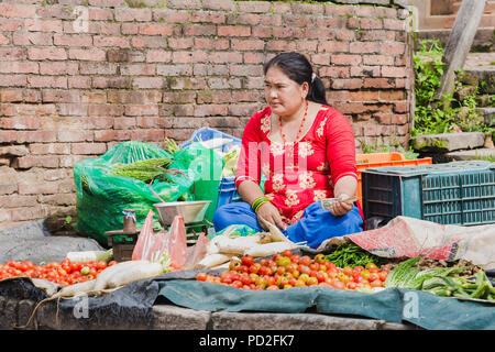 Bhaktapur,Nepal - August 4,2018 : Street vendor waiting customers to sell vegetables in bhaktapur durbar square ,Nepal. - Stock Photo