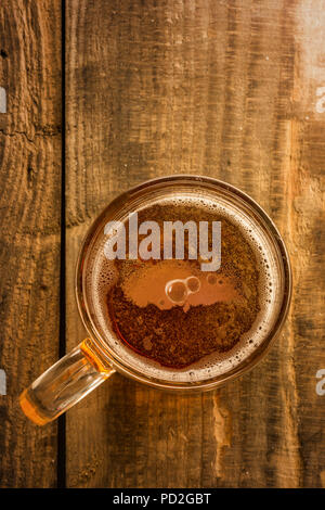 Turkish map and beer concept, Turkey silhouette on foam in beer glass on wooden table. Top view on mug of beer with foam bubbles. The national love of beer concept - Stock Photo