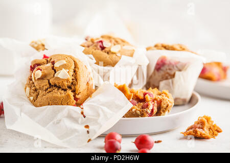 Berry oatmeal nut muffins on a white background. Healthy vegan dessert. - Stock Photo
