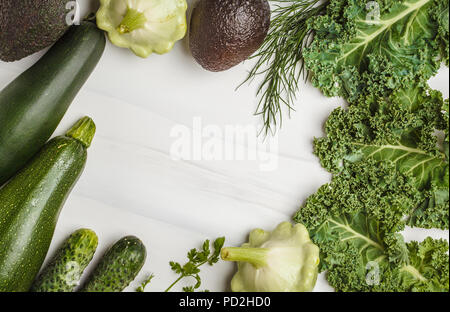 Assortment of green vegetables on white background, top view. Fruits and vegetables containing chlorophyll. - Stock Photo