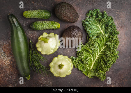 Assortment of green vegetables on dark background, top view. Fruits and vegetables containing chlorophyll. - Stock Photo