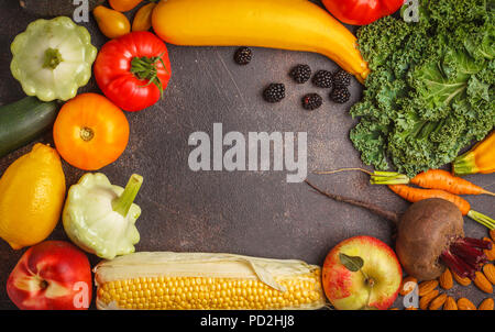 Colored fruits, vegetables and berries on a dark background. Clean eating concept, vegan food background. - Stock Photo
