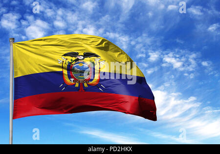 National flag of Ecuador on a flagpole in front of blue sky. - Stock Photo