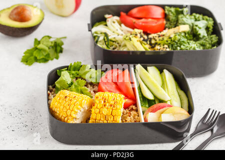 Healthy meal prep containers with quinoa, avocado, corn, zucchini noodles and kale. Takeaway food. White background, top view. - Stock Photo