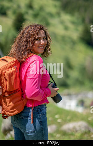 Young tourist woman taking a photo of landscape. - Stock Photo