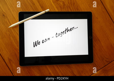 Business teams motivational message written on a tablet with stylus - Stock Photo