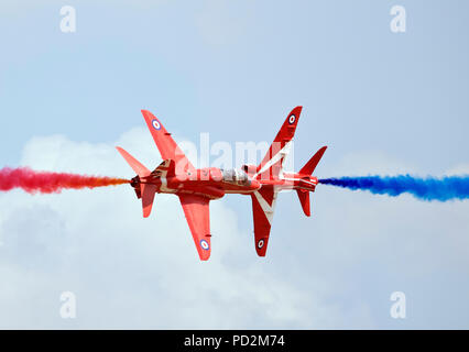 Pair Red Arrows displaying at RAF RIAT air show, Fairford 2018 - Stock Photo