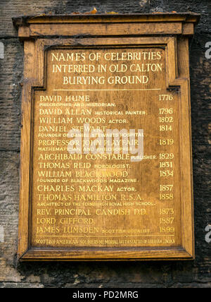 Old wooden board with list of names of famous people buried in Old Calton Burial Ground, Edinburgh, Scotland, UK includes David Hume and John Playfair - Stock Photo