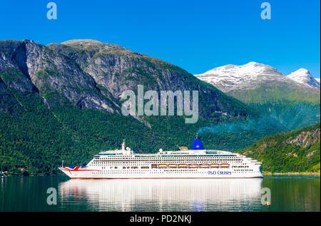 Cruiseship in Norwegian fjords - Stock Photo