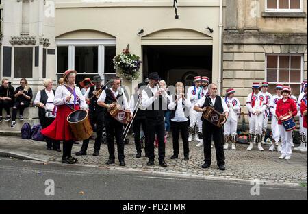 Rivington Morris dancers band at Warwick Folk Festival, Church Street, Warwick, UK - Stock Photo
