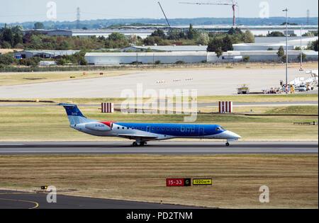 bmi Regional Embraer ERJ-145EP landing at Birmingham Airport, UK (G-RJXE) - Stock Photo