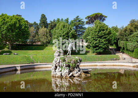 The 'Fountain of Neptune' century XVI th, in the gardens of Boboli at Florence. It is embellished with a bronze statue of the God armed of a trident. - Stock Photo