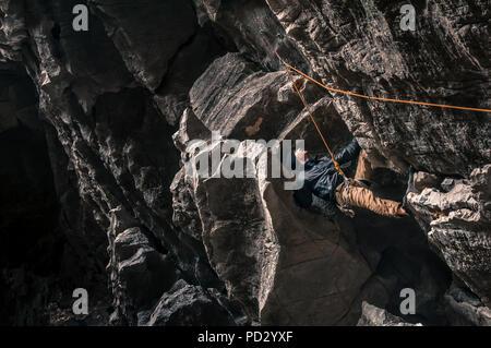 Sport climbing on limestone, in Yangshuo, Guangxi, China - Stock Photo