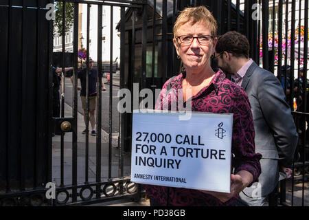 London, UK. 6th August, 2018. Kate Allen, Director of Amnesty UK, prepares to present a petition at 10 Downing Street, together with Simone Abel of Reprieve, Sam Grant of Liberty and Sonya Sceats of Freedom from Torture, calling for an independent, judge-led inquiry into the UK's involvement in the torture of detainees overseas. Credit: Mark Kerrison/Alamy Live News - Stock Photo