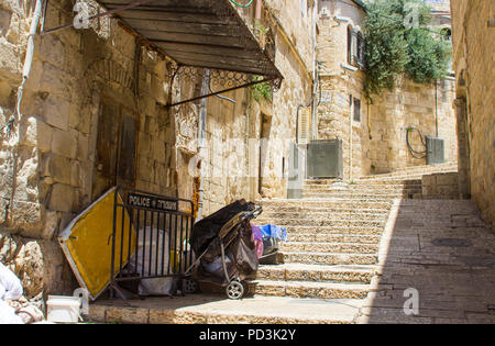 A narrow side street with rising steps off the Via Dolorosa in Jerusalem Israel - Stock Photo