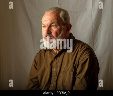 Thoughtful bearded senior man portrait, - Stock Photo