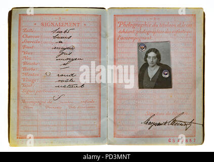 1935's vintage French passport, pages with holder description and woman photograph, - Stock Photo