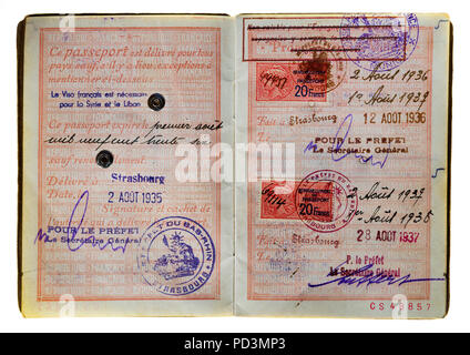 1935's vintage French passport, pages with delivery date and 1936 and 1937 renewals dates, - Stock Photo