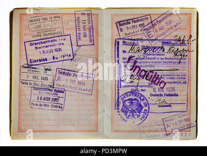 1935's vintage French passport, pages with French and German 1936 and 1937 visas stamps marks, - Stock Photo