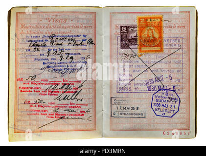 1935's vintage French passport, pages with German and Hungarian 1936 visas stamps marks, - Stock Photo
