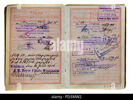 1935's vintage French passport, pages with 1936 German and French visas stamps marks, - Stock Photo