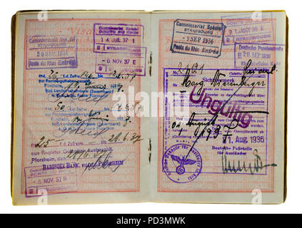 1935's vintage French passport, pages with 1936, 1937 German and French visas stamps marks, - Stock Photo