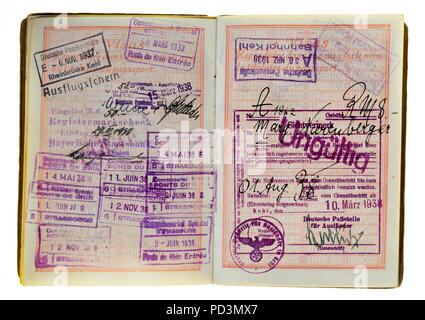 1935's vintage French passport, pages with 1937, 1938 German and French visas stamps marks, - Stock Photo