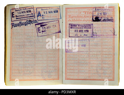 1935's vintage French passport, pages with 1938 German visas stamps marks, - Stock Photo