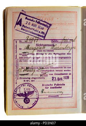 1935's vintage French passport, page with August 26 1939 German visa stamps marks - Stock Photo