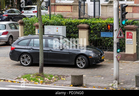 Car parked on pavement, Strasbourg, Alsace, France, Europe, - Stock Photo