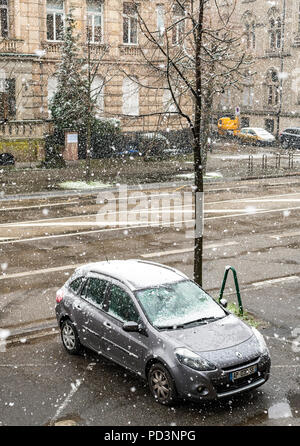 Car parked on pavement, snow storm, Strasbourg, Alsace, France, Europe, - Stock Photo