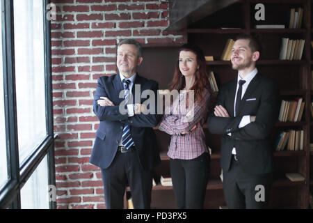 group of business partners standing in office. - Stock Photo