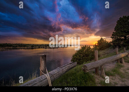 Fading supercell over lake at sunset, Ogallala, Nebraska, US - Stock Photo