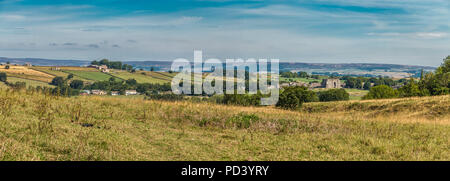 North Pennines AONB panoramic landscape, a view looking north over the viilage of Bowes, County Durham, UK including the ruins of Bowes Castle - Stock Photo