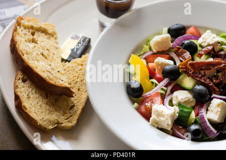 Greek Salad a great appetizer or main course - Stock Photo