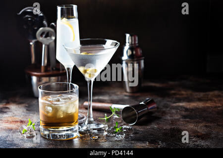 Variety of alcoholic cocktails on dark background - Stock Photo