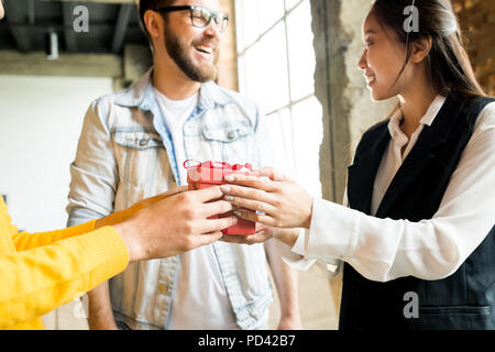 Sharing Gifts in Office - Stock Photo