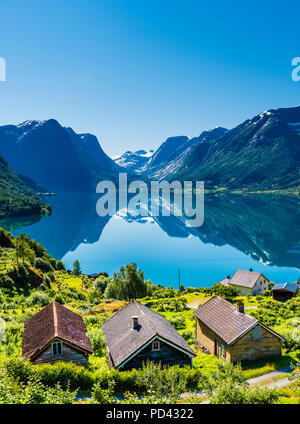 The small village Flo by the lake Oppstrynsvatnet in Western Norway - Stock Photo