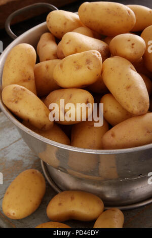 preparing fresh potatoes - Stock Photo