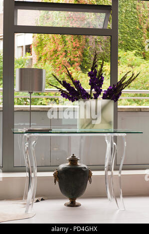 Flower arrangement in vase on table