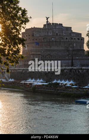 Castel Sant'Angelo al tramonto, Roma, Lungotevere. / Saint Angel's Castle at sunset, Rome, Lungotevere. - Stock Photo