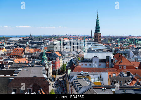 View over city from Rundetaarn (Round Tower) looking towards spire of the Nikolaj Contemporary Art Center (St Nicholas Church), Copenhagen, Denmark - Stock Photo