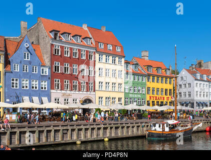 Historic buildings along Nyhavn canal, Copenhagen, Denmark. The oldest house is no 9 on the far left (blue building), Copenhagen, Denmark - Stock Photo