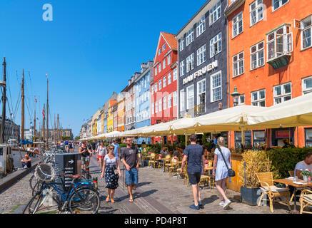 Nyhavn, Copenhagen. Cafes, bars and restaurants along the historic Nyhavn canal, Copenhagen, Denmark - Stock Photo