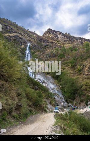 Trek around the Annapurna, Himalayas, Nepal-09.04.2018: beautiful waterfall in spring day April 9, 2018 trek around the Annapurna, Himalayas, Nepal. - Stock Photo