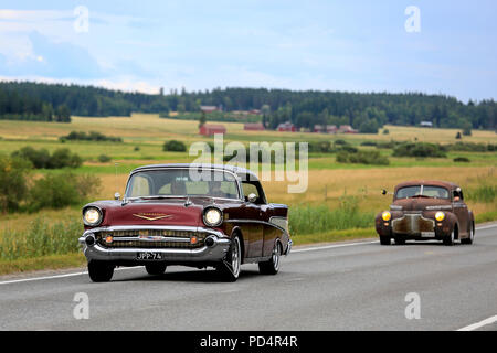 VAULAMMI, FINLAND - AUGUST 4, 2018:  Two vintage cars, 1950s Chevrolet in the front, on Maisemaruise 2018 car cruise in Tawastia Proper, Finland. - Stock Photo