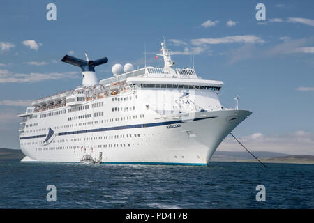 MS Magellan, a Cruise and Maritime Voyages cruise ship, at anchor in Orkney, Scotland - Stock Photo